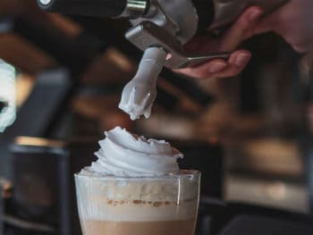 Preparing delicious coffee drink whipped